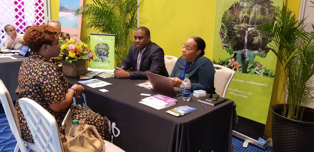 TTAL CEO Louis Lewi and Marketing Coordinator Sheena Des Vignes meets with an attendee at CTM 2020